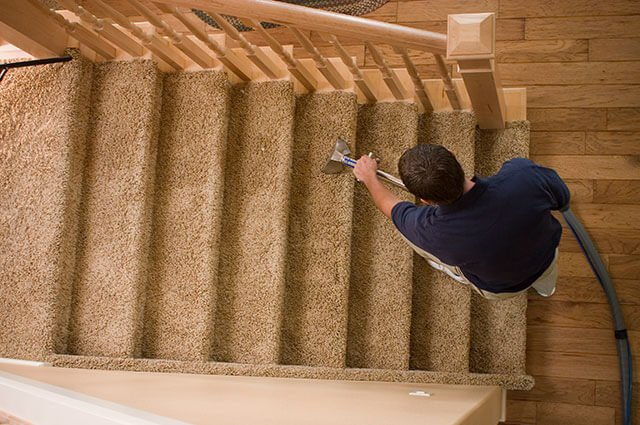Healthy Life Chem-Dry Technician performing Carpet Cleaning Service on stairs